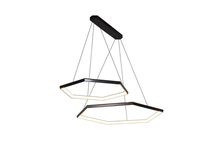 HEXIA DUO HXD46 is a linear pairing of two of our HEXIA fixtures. Two rings are suspended from a linear canopy, in an asymmetric arrangement. This fixture can be customized to utilize different sizes. Multiple fixtures can be added to create a