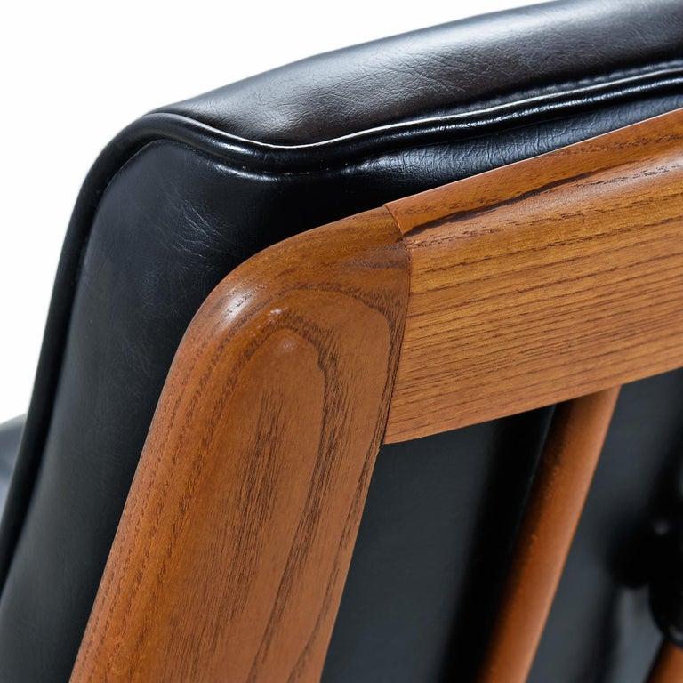 Mid-20th Century Heywood Wakefield 710D Black Naugahyde Swivel Rocker Lounge Chair and Ottoman For Sale