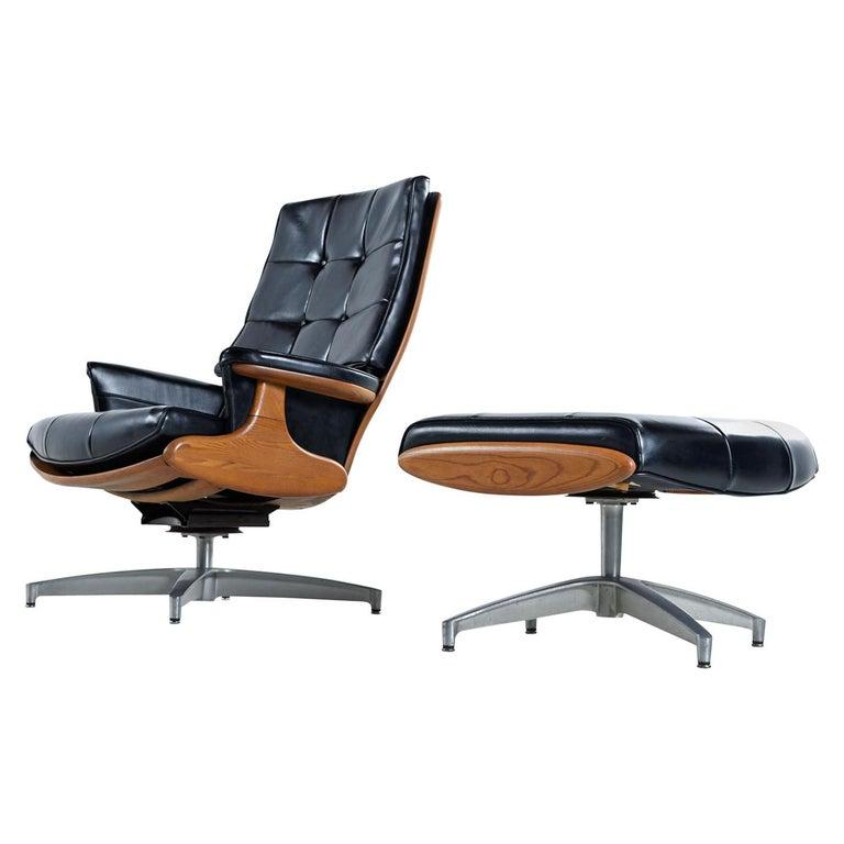 Heywood Wakefield 710D Black Naugahyde Swivel Rocker Lounge Chair and Ottoman For Sale