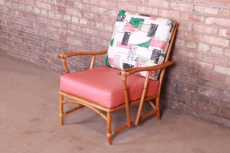 An exceptional all original mid-century modern Hollywood Regency club chair or lounge chair  By Heywood Wakefield  USA, 1950s  Bamboo form solid ash wood, with original vinyl upholstered cushions.  Measures: 27