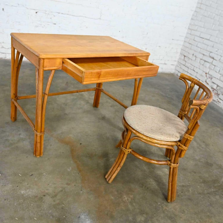 Awesome vintage Heywood Wakefield rattan and maple writing desk that we have paired with a low back rattan chair with a tweed fabric seat by Sovereign Furniture. Beautiful condition, keeping in mind that these are vintage and not new so will have