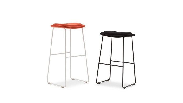 Hi Pad stool in fabric or leather and stainless steel or lacquered legs by Jasper Morrison for Cappellini.  With a low profile and minimal foot print, the Hi Pad stool has proven to be among the most popular and successful products within the