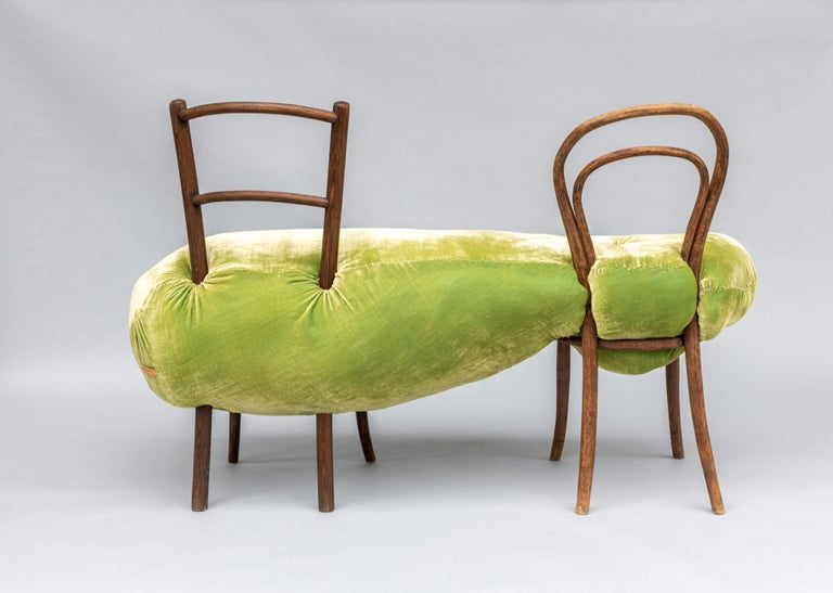 Squishy Thonet II is a continuation of the Hi!breed family. This is a bench made up from two old Thonet bentwood chairs enveloped with plump upholstery. Acid green silk velvet encases the form, which is all hand stitched. The chairs have a solid