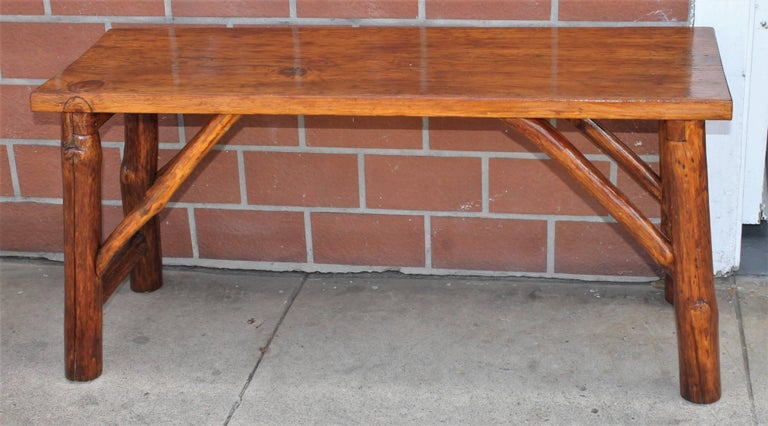 This Fine and rustic hickory bench is in fine condition and could be used as a coffee table as well. This is very sturdy and strong.