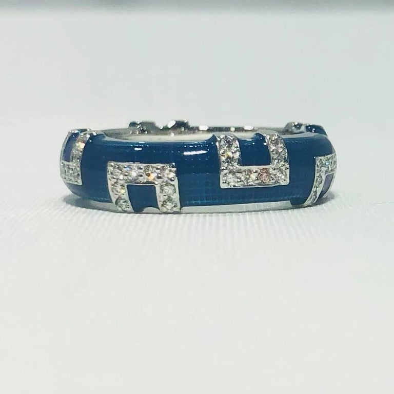Hidalgo 18 karat white gold and diamonds with bright blue enamel band ring. This is a brilliant classic Hidalgo creation. Known for their enamel work and stackable band rings, Hidalgo is a collectible and most valuable piece to own. This ring is 18
