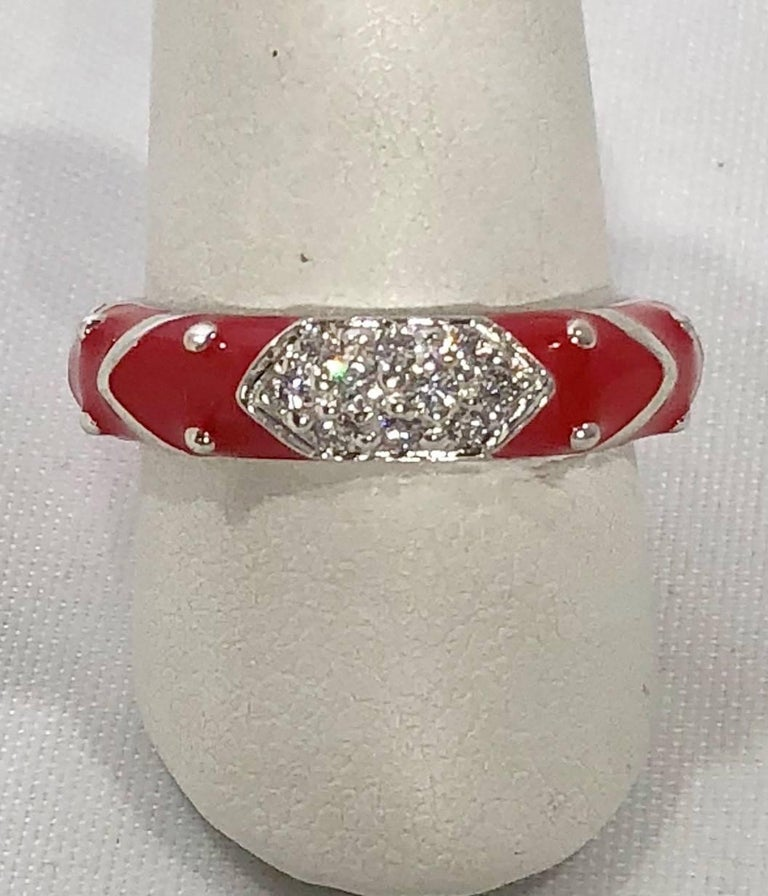 Hidalgo 18 karat white gold, diamonds, and red enamel stackable ring. This Hidalgo piece is created in 18 karat white gold and weighs 4.9 grams, 3.1 dwt.. There are 9 full cut round diamonds average color G-H, average clarity VS2. Bright candy Red