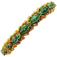 Hidalgo 18 Karat Yellow Gold, Green Enamel and Ruby Frog Bracelet