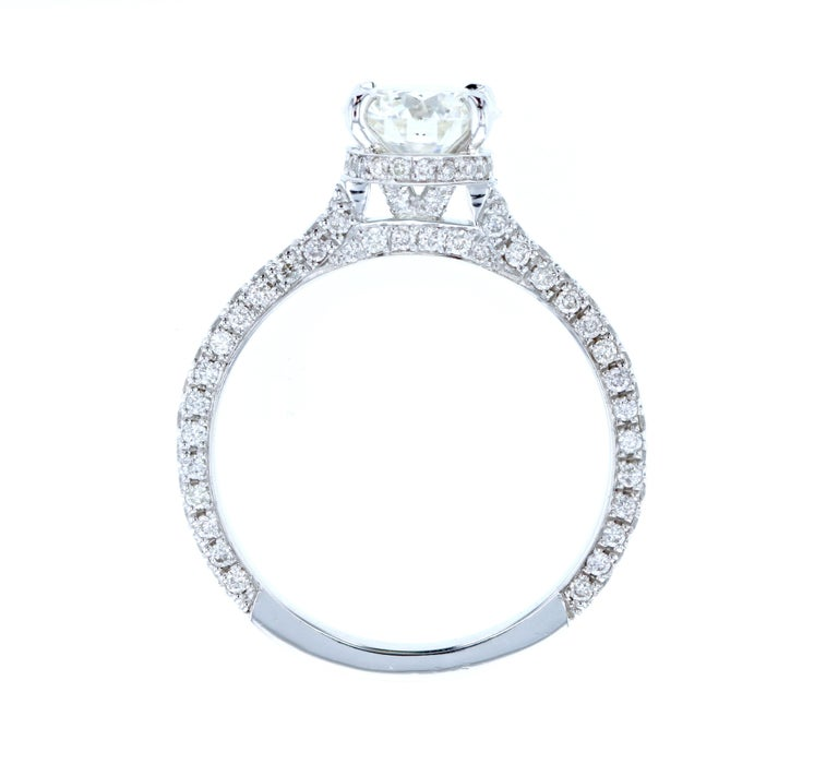 This diamond ring is crafted in platinum, contains a Round Brilliant Cut Diamond (1.24 total carat weight, I color, SI1 clarity) surrounded by 125 Round Brilliant Cut Diamonds (0.70 total carat weight, I color, VS clarity).  A hidden halo is the