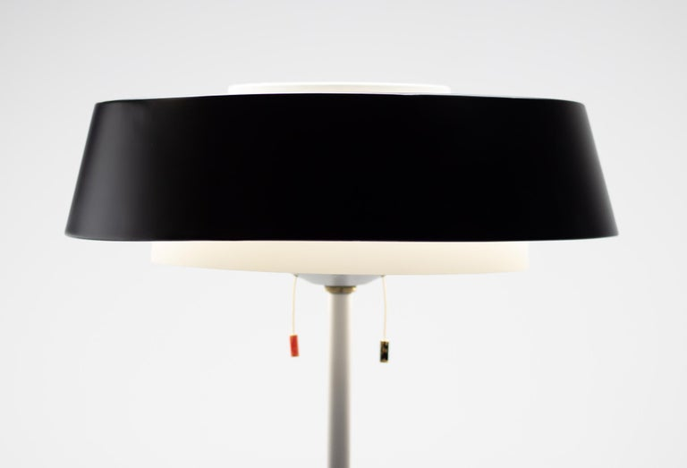 This modernist floor lamp is without a doubt a true Mid Century Modern Dutch Design classic.  The lamp is as functional as it looks: the shade is equipped with four bulbs: three downlighting and one facing upward.  The two switches allow the lamp