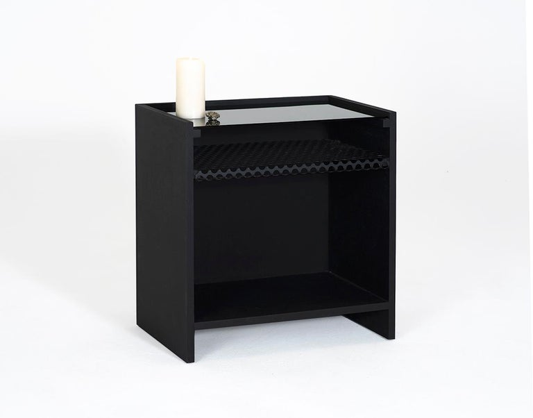 The Hierarchy table was designed to be used as a nightstand, but can also be used as a side table. The name of the piece comes from the array of materials used in the varying levels of the table. A perforated steel shelf adds versatility of use, as
