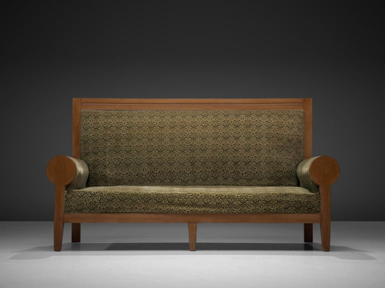 Sofa in beech and fabric, Europe, 1940s.  A stately settee in green fabric upholstery. This bench has a majestic appearance, due the high back and luxurious upholstery. The rounded armrests emphasize this royal expression. The warm colored wood