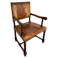 High-Back Caramel Leather Chair with Carved Wood Detail