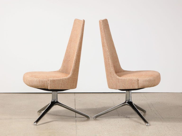 Polished aluminum, steel, fabric. Rare set of custom dining/ desk chairs designed by father & daughter and Produced by ABV. Sleek upholstered seats supported by tri-legged swivel bases. These chairs were originally Design for a project in Palm