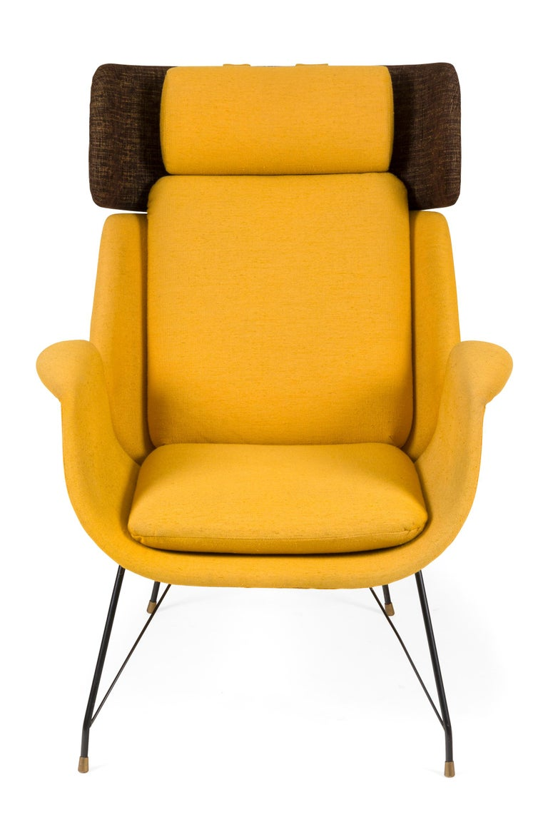 A rare pair of lounge chairs by the elusive Augusto Bozzi. Given the number of highly successful designs he created for Saporiti I would expect his name to have more recognition. These chairs have a fascinating method connecting the back and seat in
