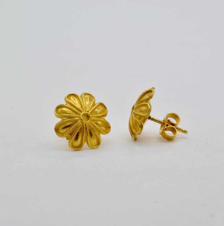 These statement 18K yellow gold flower earrings are a beautiful museum reproduction curated for your personal collection. The bright yellow of the high carat gold creates a regal fashion timeless throughout the centuries and fit for a queen.