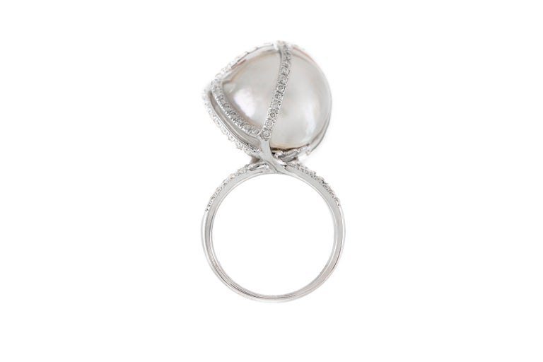 The ring is finely crafted in 18k white gold with center pearl and diamonds weighing approximately total of 1.50 carat.