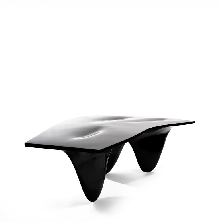 Zaha Hadid's voluptuous Aqua table is an uninterrupted whole – a curious and curvaceous form that invites viewers to engage with it. Standing as an impressive centrepiece it delivers a stylish focal point in any space. The three fin-like legs of the