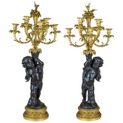 High Quality Pair of Patinated and Gilt Bronze Figural Candelabras