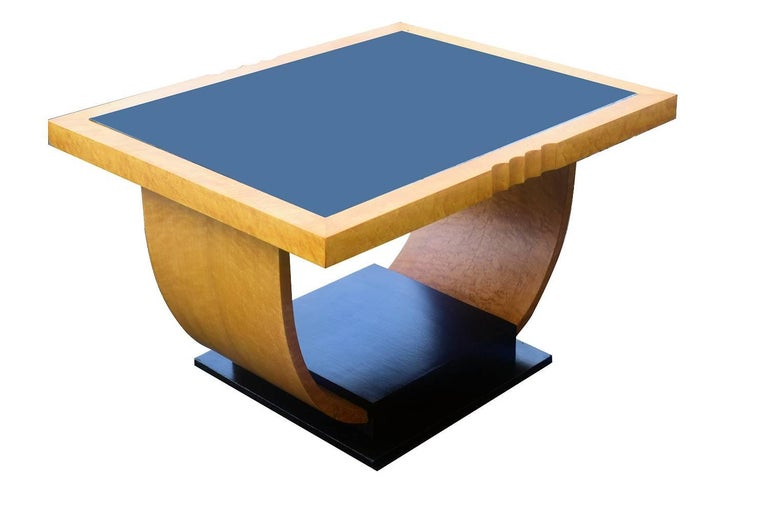 For your consideration is this fabulously stylish Art Deco English occasional table. Light blonde maple veneer is accentuated beautifully with the ebonised woods. Black glass top, so easily maintained and cleaned. Generously proportioned so could