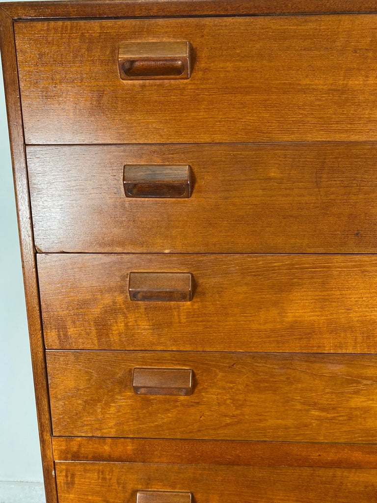 Stunning Teak  High dresser by Borge Mogensen for Neils Vodder, Denmark 1950s. A tall seven (7) drawer dresser or chest of drawers designed by Borge Mogensen. Dresser is constructed of solid teak wood with integrated wood handles on an oak base with