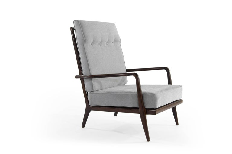 Sculptural high back walnut lounge chair designed by Mel Smillow, circa 1950s.  Walnut fully restored. New cushions upholstered in grey cotton linen.