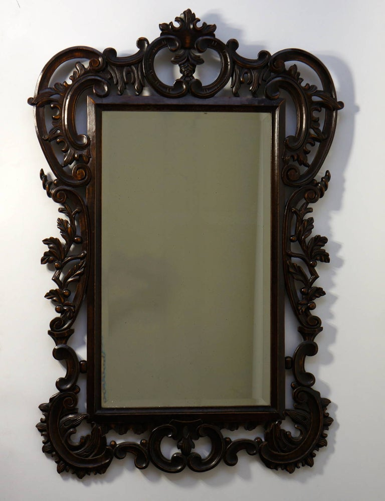 A large, highly carved vintage mirror in the Baroque style with beautiful patine. This item is great for formal and informal setting. Beach house or city loft, this mirror covers it all. Measures: Height 103 cm. Width 72 cm.