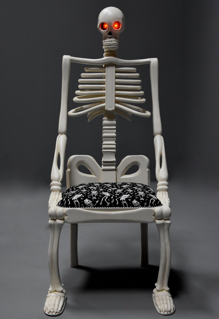 Highly decorative and unusual hand-carved and painted wooden skeleton chair.