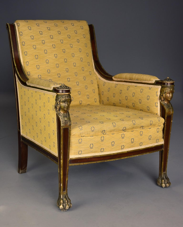 A highly decorative early 20th century French Empire style mahogany armchair with typical Egyptian influence.