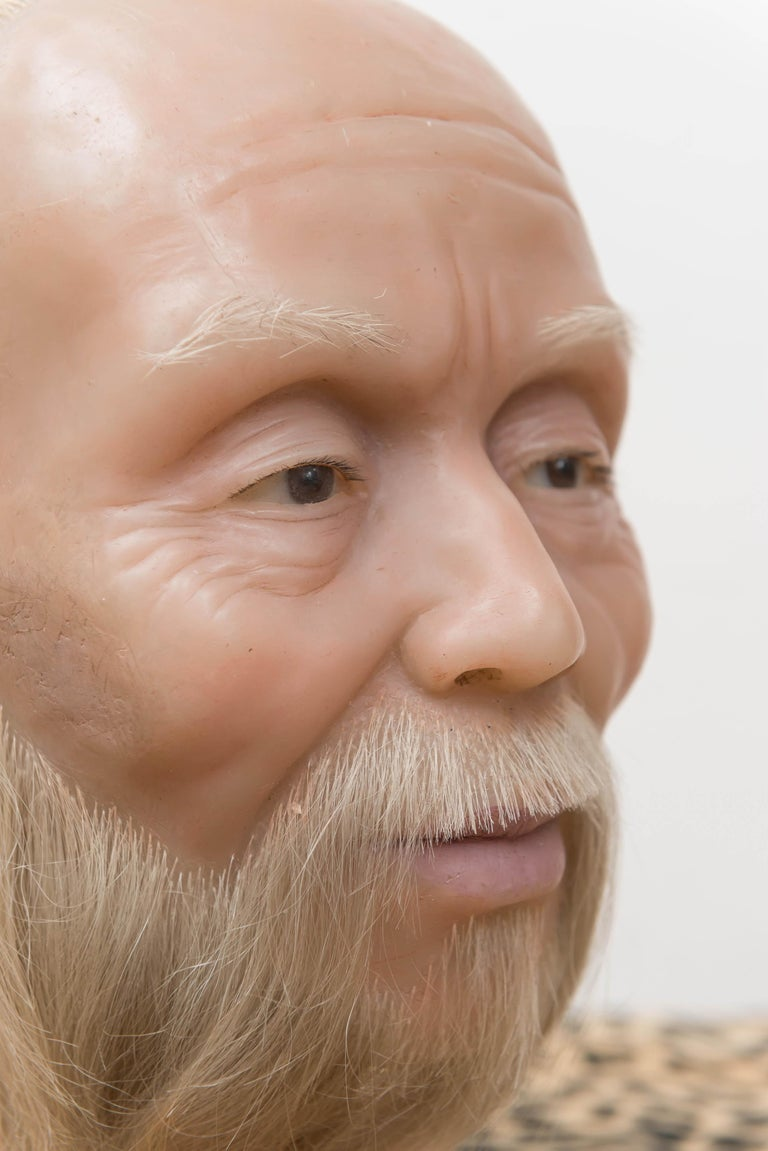 A highly realistic wax head of a Chinese man, mid-20th century. Sits on a simple, flat wooden base. From the Old San Francisco Chinatown Wax Museum, circa 1960. This museum was designed as a legacy to Chinese culture and Chinese in San