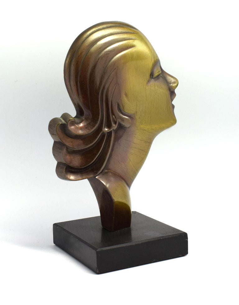 Sourced in Chateauroux, France, this is a solid brass profile of an Art Deco female surmounted on a black slate base. She dates to the 1930s and is in great condition and free from damage.