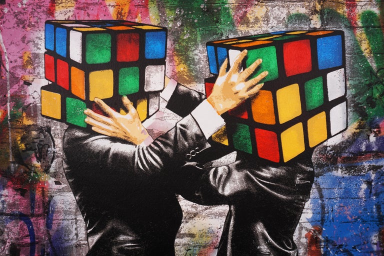'Puzzled II' by Hijack is a silkscreen and mixed media painting on canvas, created in 2020. Signed by the Artist, this work possesses striking subject matter and the street-style flair Hijack has become well-known for. 'Puzzled II' comes in metallic