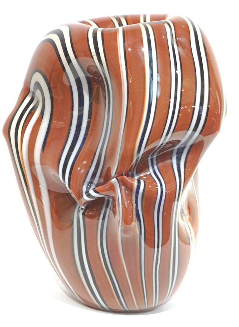 One-of-a-kind organic modern glass sculpture signed by Hilton McConnico for Formia, Murano, designed and blown in the 1990s. The overlaid glass has been worked in an innovative sensual scrunch shape that looks like crumpled fabric, this similarity