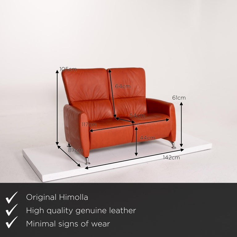 We present to you a Himolla Cumuly leather sofa orange two-seat couch.      Product measurements in centimeters:    Depth 87 Width 142 Height 105 Seat height 44 Rest height 61 Seat depth 54 Seat width 117 Back height 64.