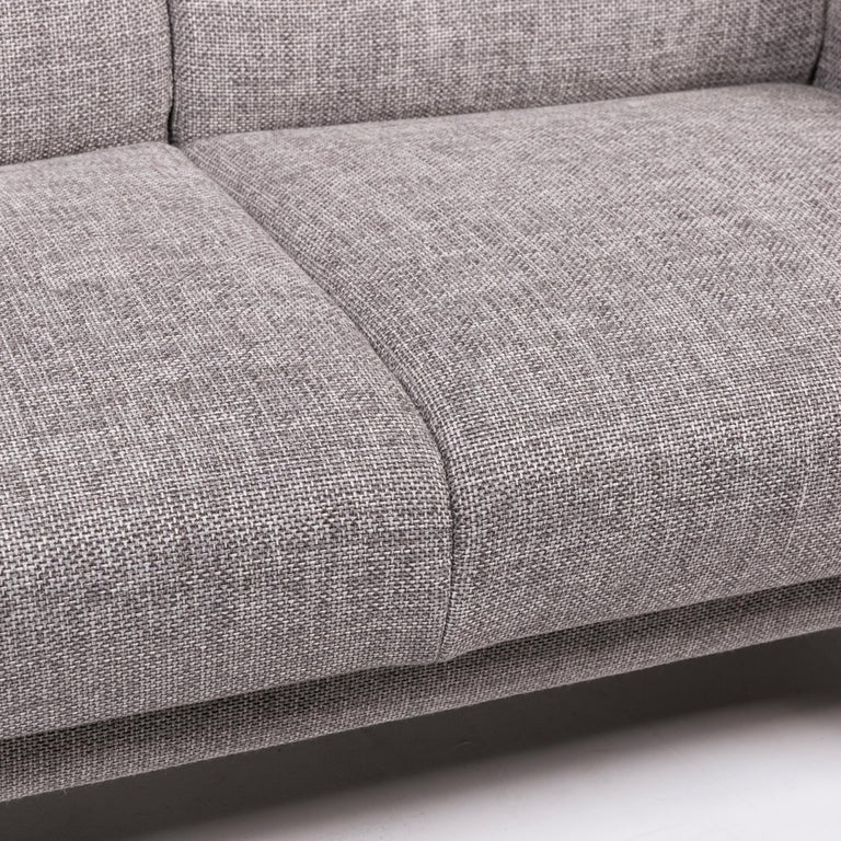 We present to you a Himolla fabric sofa gray two-seat couch.      Product measurements in centimeters:    Depth 82 Width 128 Height 101 Seat height 47 Rest height 65 Seat depth 53 Seat width 107 Back height 55.