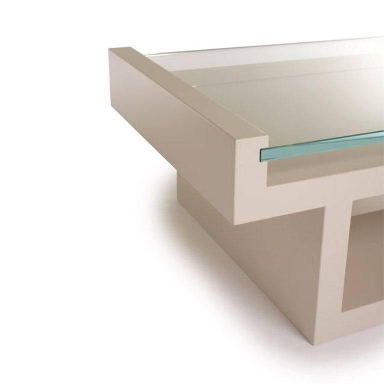 The stunning Hinge table is a harmonious balance between its sleek sophisticated glass top and the strong lacquered base into which it is set. Clean lines and strong angles of this coffee table make this a bold choice for any space.