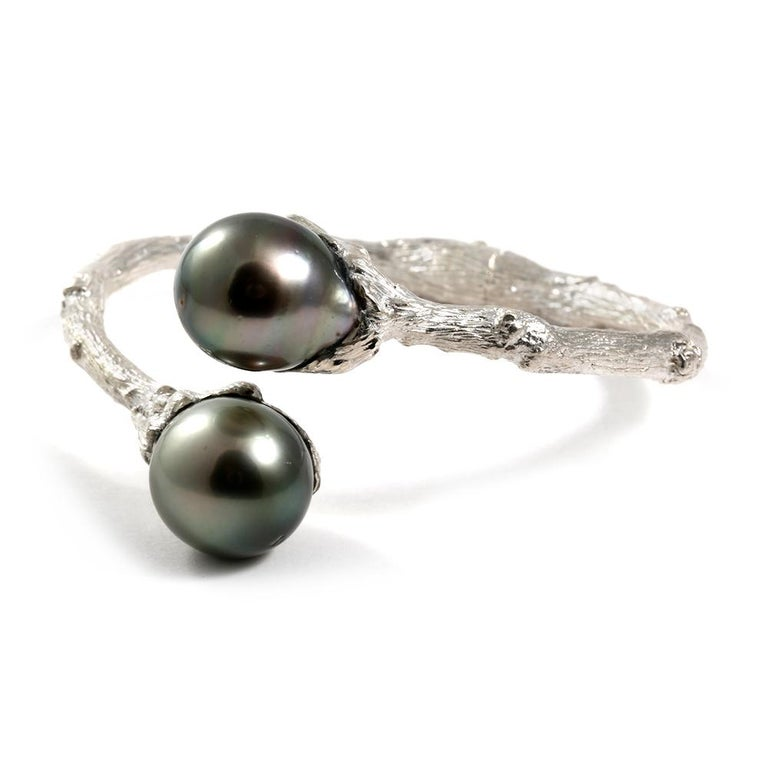 From the K. Brunini Twig Collection, a hinged bypass bracelet in Sterling Silver with vibrant Tahitian Pearls. Because all pearls are unique, each bracelet is a one-of-a-kind work of art.   Great piece for any occasion - from casual to formal.