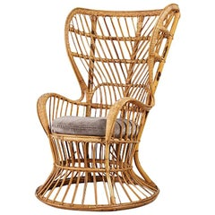 Hip Rattan Lounge Chair with Brown Removable Cushion by Leo Carminati, c 1948
