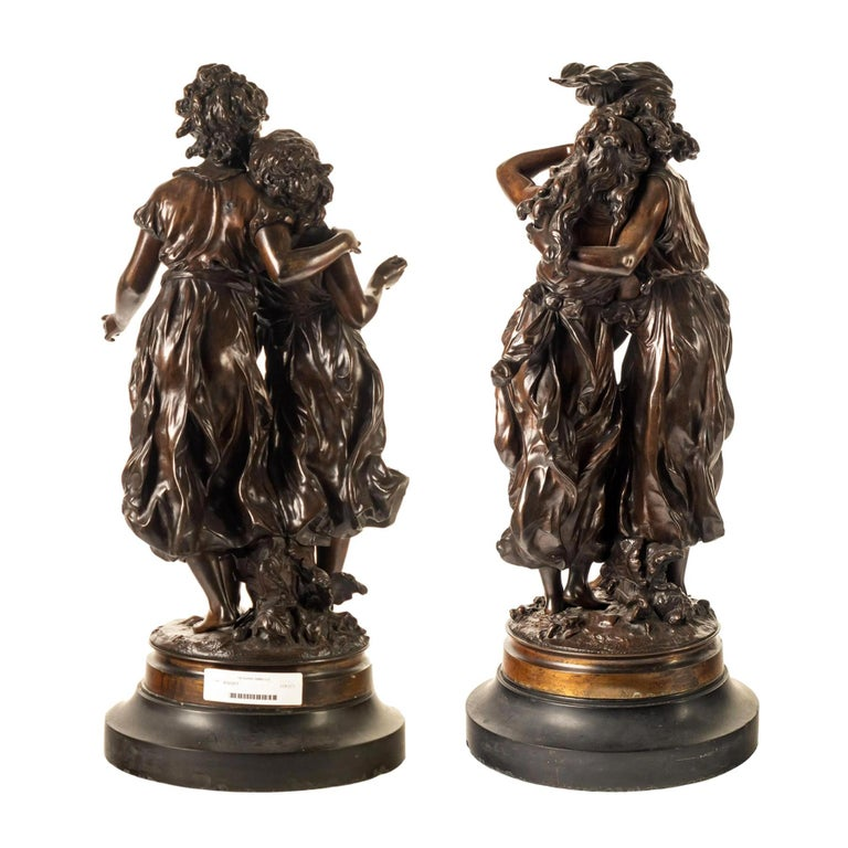 HIPPOLYTE FRANÇOIS MOREAU   French, (1832-1927)  'Eaves Dropping' and 'Consolation'  Patinated bronze; signed 'Moreau'  25 x 11 inches
