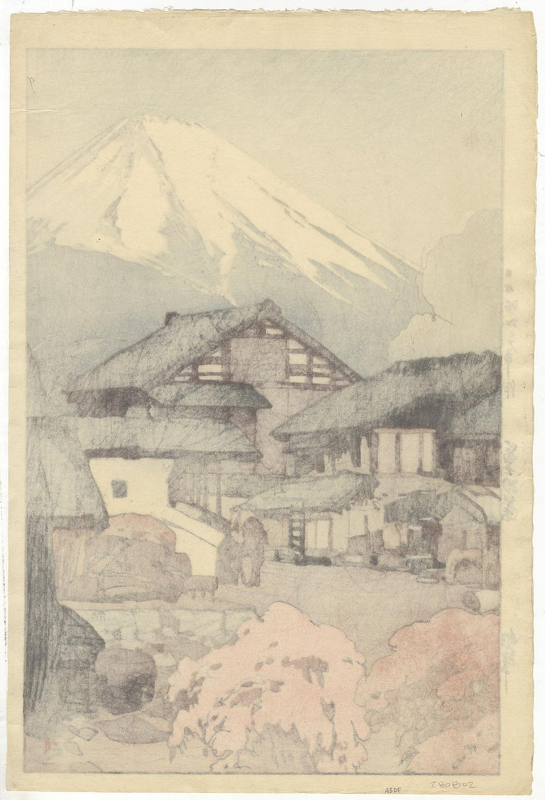 Artist: Hiroshi Yoshida (1876-1950) Title: Fuji from Funatsu Series: Ten Views of Fuji Date: 1928 Dimensions: 27.3 x 40.6 cm Printed and signed by the artist.  A snow capped Mt Fuji looms over the small station town of Funatsu. Located near Lake