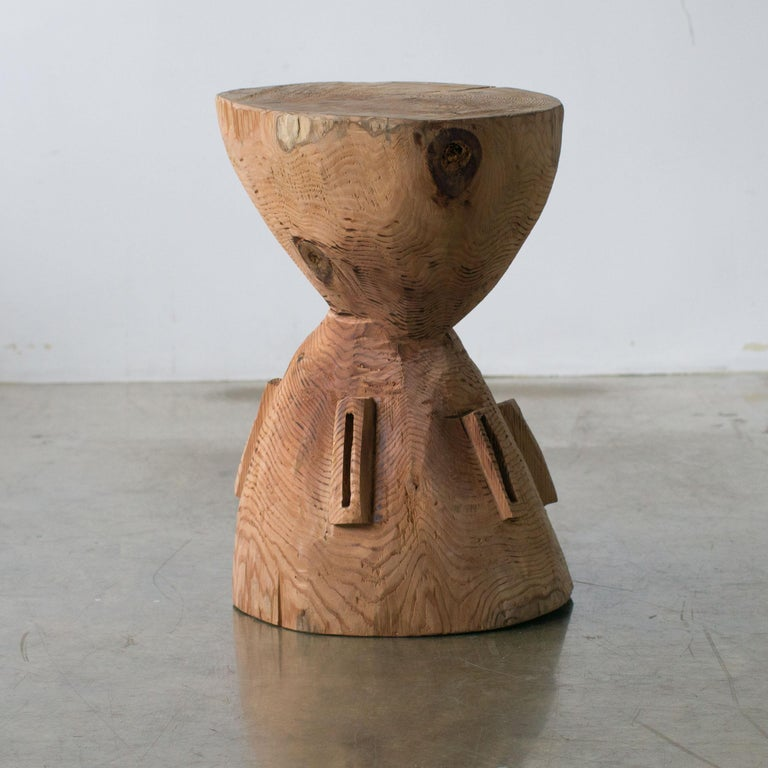 Name: Spaceship Sculptural stool by Hiroyuki Nishimura and zone carved furniture Material: Cypress. This work is carved from log with some kinds of chainsaws. Most of wood used for Nishimura's works are unable to use anything, these woods are
