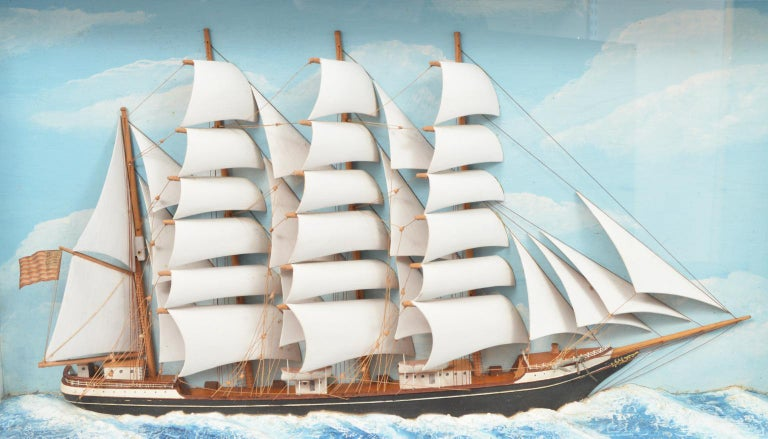 This great historic diorama likely dates to the first part of the 20th century. It represents a four-masted barque flying the Stars and Stripes cruising at full sail on white capped seas. The diorama bears a typed inscription along the bottom edge