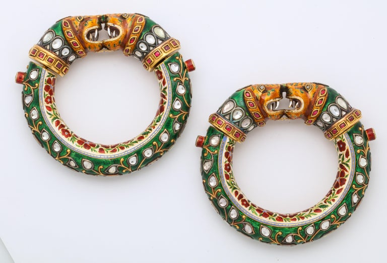A Historic Pair of Indian Tiger Head Bangles  From the legendary collection of the Nizam of Hyderabad  One of the largest of this type of bangle we have ever seen.  Enamel and gem set on high karat gold  Made in North India late 19th Century  Each: