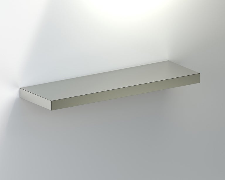 Hitan Shelf is a floating decorative shelf entirely covered by HPL Aluminium. The manufacturing process and research on metal surfaces treatment and finishing allows highlighting the shine and brightness of aluminum.  Hitan is entirely