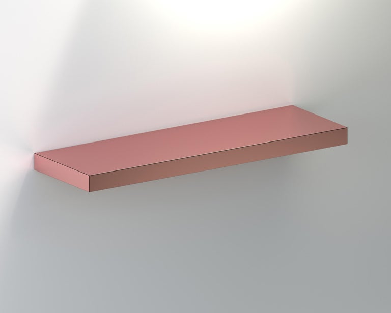 Hitan shelf is a floating decorative shelf entirely covered by HPL aluminum.  The manufacturing process and research on metal surfaces treatment and finishing allows to highlight the shine and brightness of aluminum.  Hitan is entirely