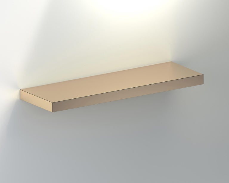 Hitan shelf is a floating decorative shelf entirely covered by HPL Aluminium.  The manufacturing process and research on metal surfaces treatment and finishing allows to highlight the shine and brightness of aluminum.  Hitan is entirely