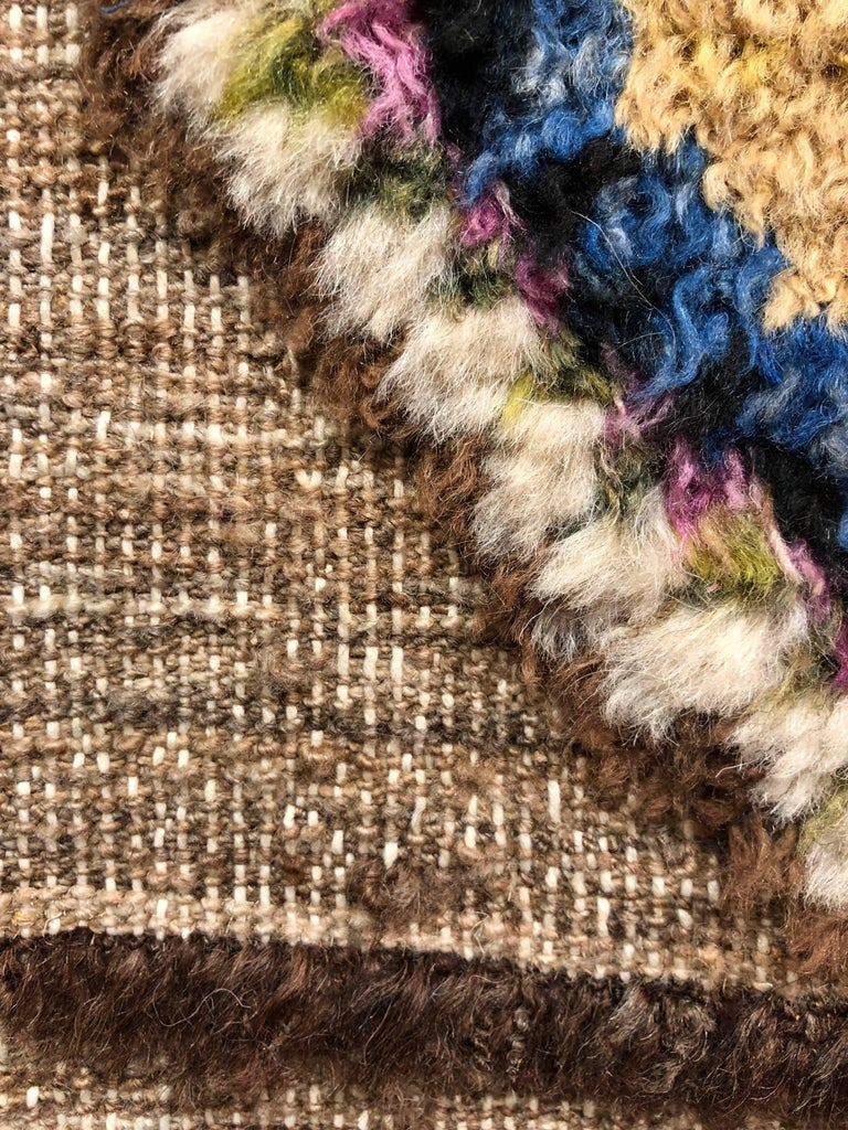 This hand-knotted wool rug is one of our more neutral offerings in our rug collection. This pairs a little novelty with the black line of bottle shapes about 2/3 down the rug along with some fun polka dot tufts at the top of the rug (as shown) some