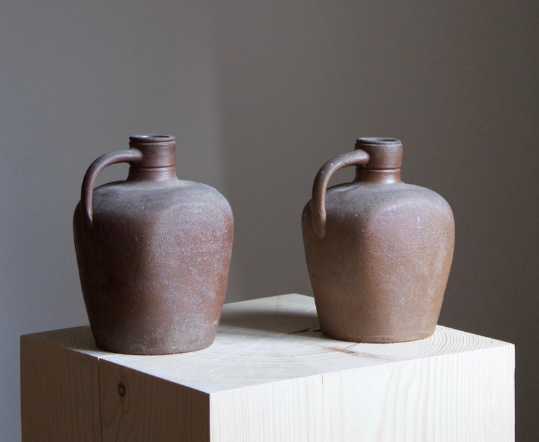 A pair of vases / bottles by Höganäs Keramik. Stamped.