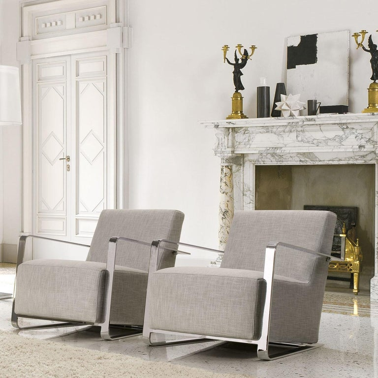 An effortless combination of comfort and elegance, this upholstered armchair will add a touch of sophistication to any private study or living room decor. Its clean lines are enhanced by the industrial-inspired chrome metal frame that provides a