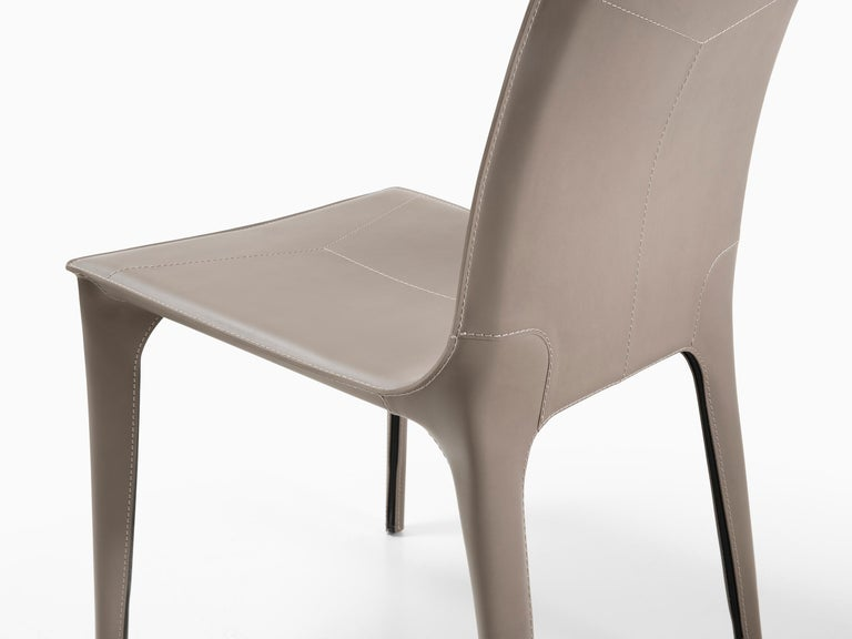 HOLLY HUNT Adriatic dining side chair in pine bark leather. This simple and elegant dining chair is covered in Italian saddle Leather. From the slightly curved back and slender legs, the lines of this chair flow one into the next for a seamless,
