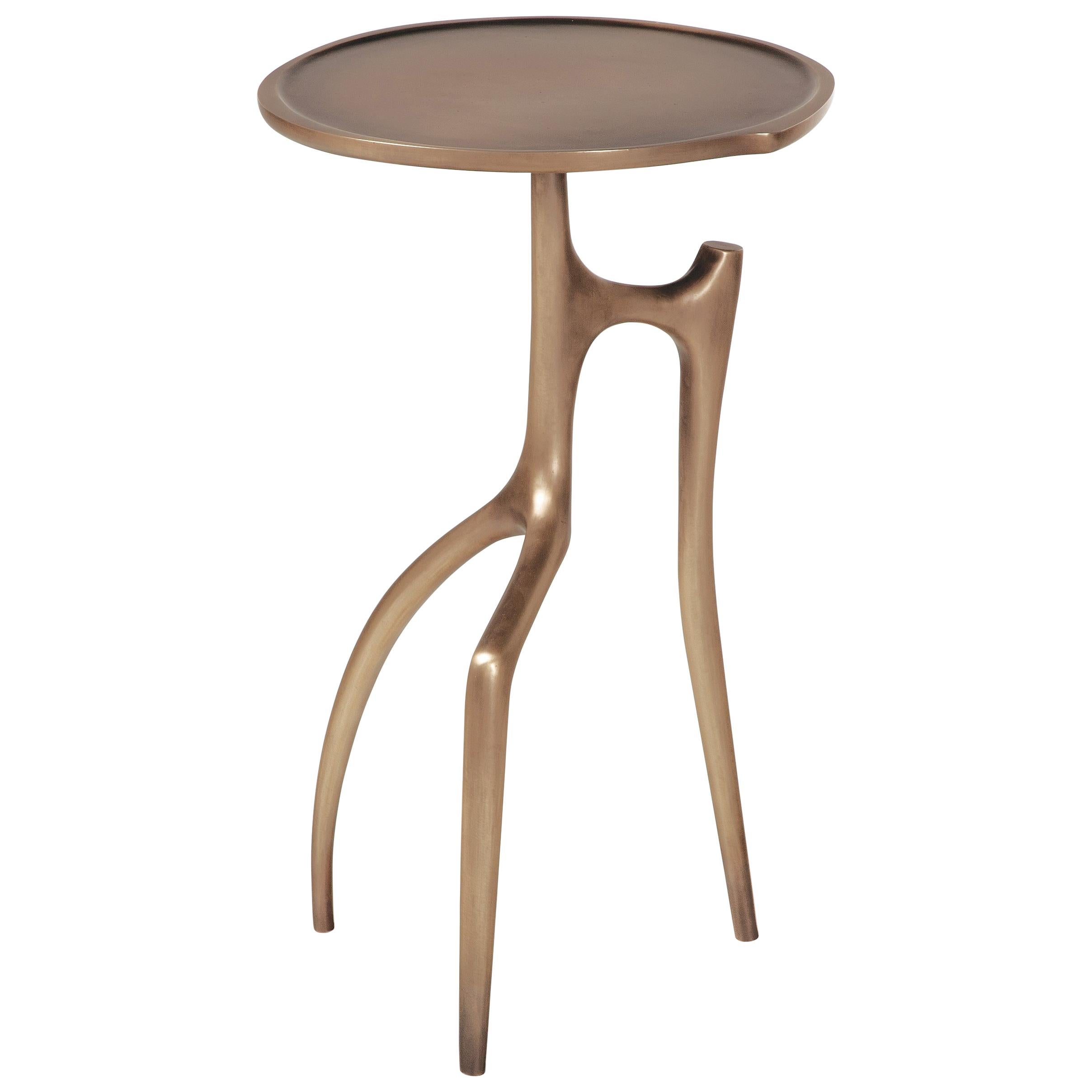 The Holly Hunt patinated-bronze Branche side table, named for its arboreal legs
